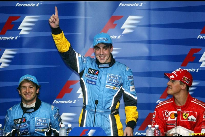 Fernando Alonso, Renault, pleased with his first pole position. Press conference after Fernando Alonso, Flavio Briatore and Jarno Trulli celebrate Renault's front row. Saturday qualifying for the Malaysian GP. Sepang, March 22nd 2003.