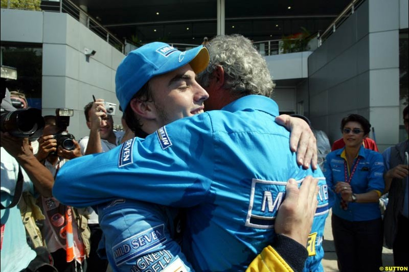 Fernando Alonso and Flavio Briatore celebrate Renault's front row. Saturday qualifying for the Malaysian GP. Sepang, March 22nd 2003.