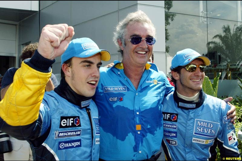 Fernando Alonso, Flavio Briatore and Jarno Trulli celebrate Renault's front row. Saturday qualifying for the Malaysian GP. Sepang, March 22nd 2003.