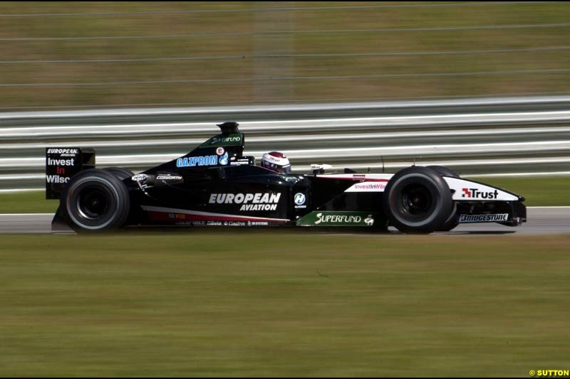 Jos Verstappen, Minardi, during Saturday qualifying for the Malaysian GP. Sepang, March 22nd 2003.