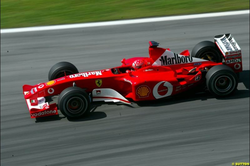 Michael Schumacher, Ferrari, during Saturday qualifying for the Malaysian GP. Sepang, March 22nd 2003.