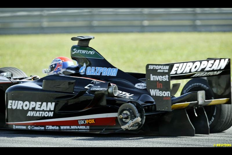 Justin Wilson, Minardi, loses a tyre during Saturday practice for the Malaysian GP. Sepang, March 22nd 2003.