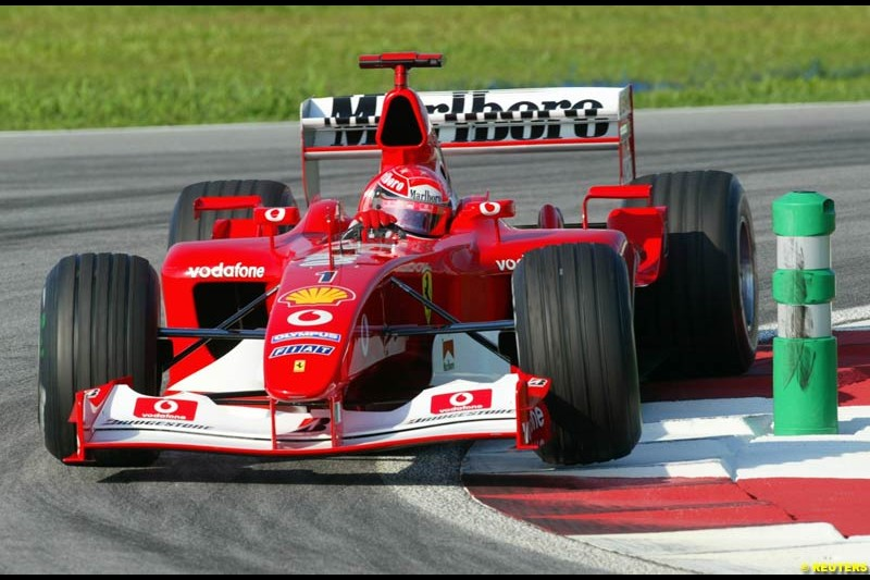 Michael Schumacher, Ferrari, during Saturday practice for the Malaysian GP. Sepang, March 22nd 2003.