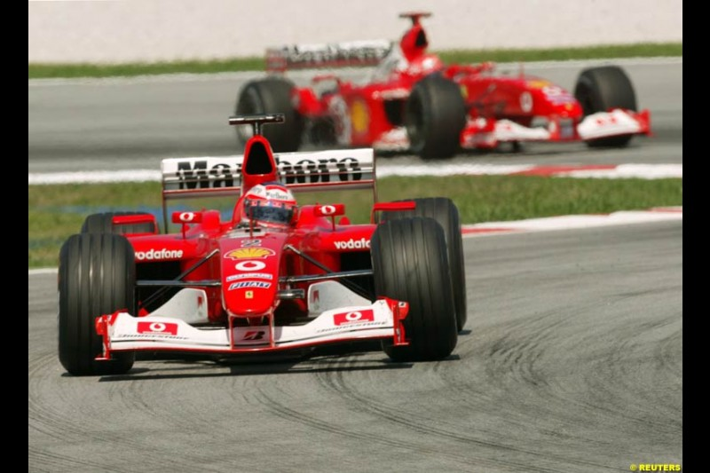 The Ferraris during Saturday practice for the Malaysian GP. Sepang, March 22nd 2003.