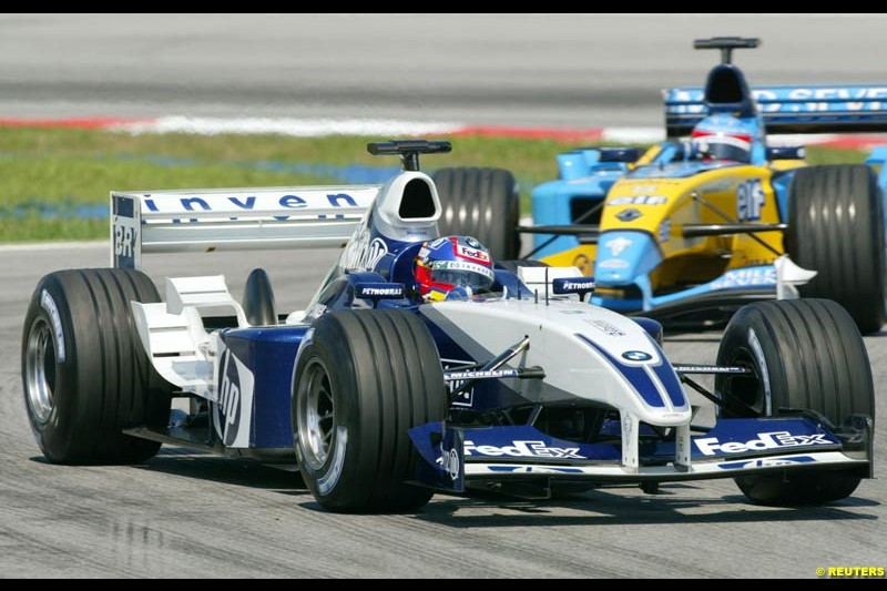 Juan Pablo Montoya, Williams, followed by Fernando Alonso, Renault, during Saturday practice for the Malaysian GP. Sepang, March 22nd 2003.