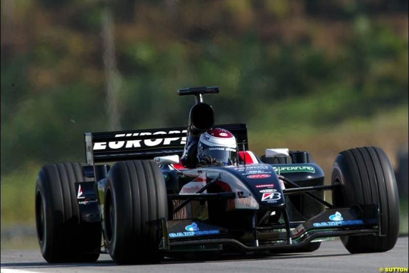 Jos Verstappen, Minardi, during Saturday practice for the Malaysian GP. Sepang, March 22nd 2003.
