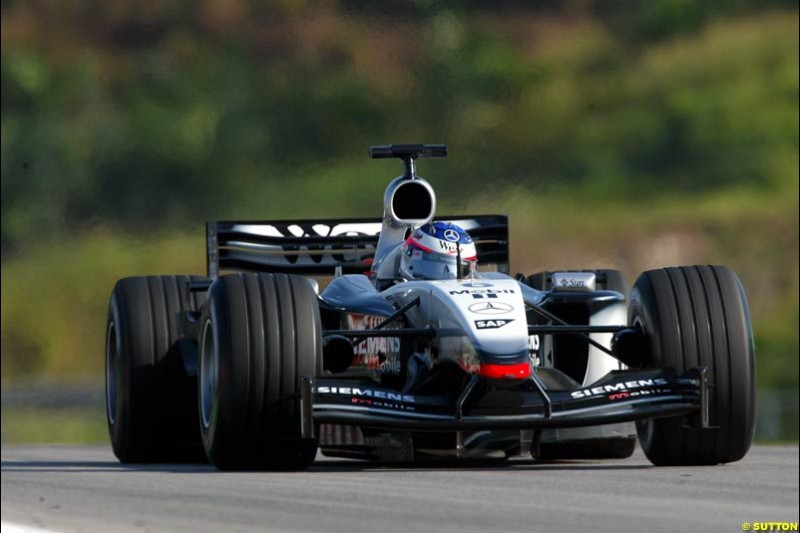 Kimi Raikkonen, McLaren, during Saturday practice for the Malaysian GP. Sepang, March 22nd 2003.
