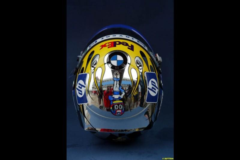 Juan Pablo Montoya presents a specially-designed helmet at the Brazilian Grand Prix. Interlagos, Sao Paulo, April 4th 2003.