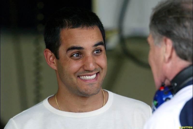 Juan Pablo Montoya puts a happy face for Patrick Head. Saturday qualifying for the Brazilian Grand Prix. Interlagos, Sao Paulo, April 5th 2003.