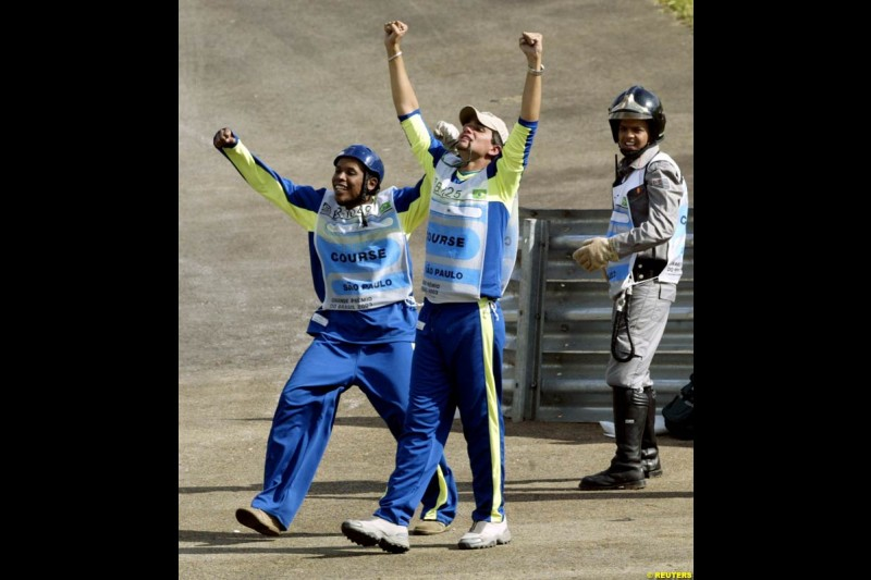 Brazilian track stewards thrilled with local boy Rubens Barrichello being on pole, after qualifying for the Brazilian Grand Prix. Interlagos, Sao Paulo, April 5th 2003.