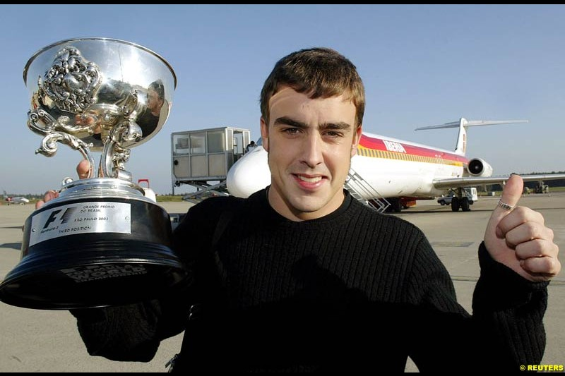 Fernando Alonso with his third place trophy from the Brazilian GP. April 8th 2003.