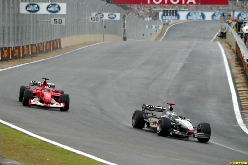 David Coulthard, McLaren, leads Rubens Barrichello, Ferrari, during the Brazilian Grand Prix. Interlagos, Sao Paulo, April 6th 2003.