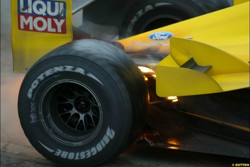 Giancarlo Fisichella, Jordan, suffers a small fire. Brazilian Grand Prix. Interlagos, Sao Paulo, April 6th 2003.