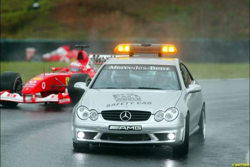 The pace car is followed by Rubens Barrichello, Ferrari. Brazilian Grand Prix. Interlagos, Sao Paulo, April 6th 2003.