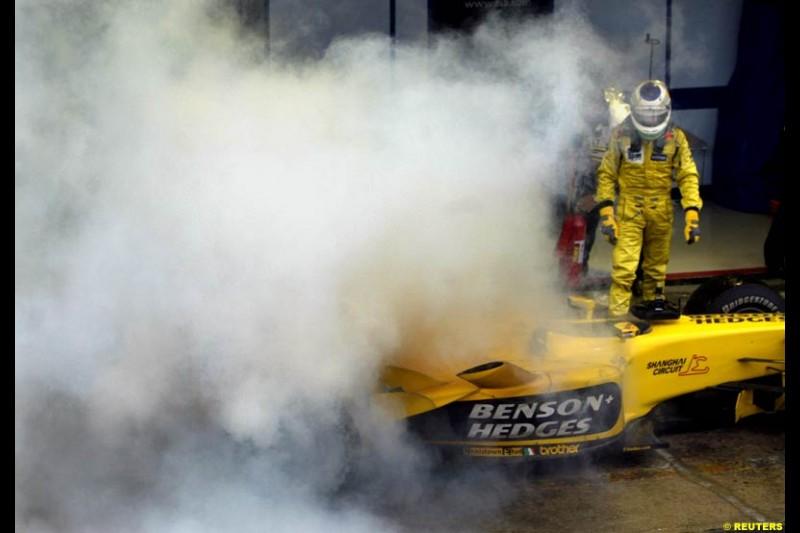 Giancarlo Fisichella's Jordan suffers a small fire at the end of the race. Brazilian Grand Prix. Interlagos, Sao Paulo, April 6th 2003.