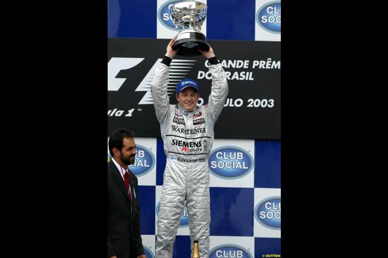 Kimi Raikkonen, McLaren, celebrates victory. Brazilian Grand Prix. Interlagos, Sao Paulo, April 6th 2003.