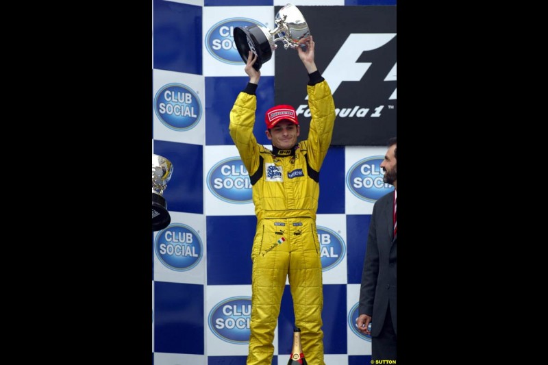 Giancarlo Fisichella, Jordan, celebrates second place. Brazilian Grand Prix. Interlagos, Sao Paulo, April 6th 2003.