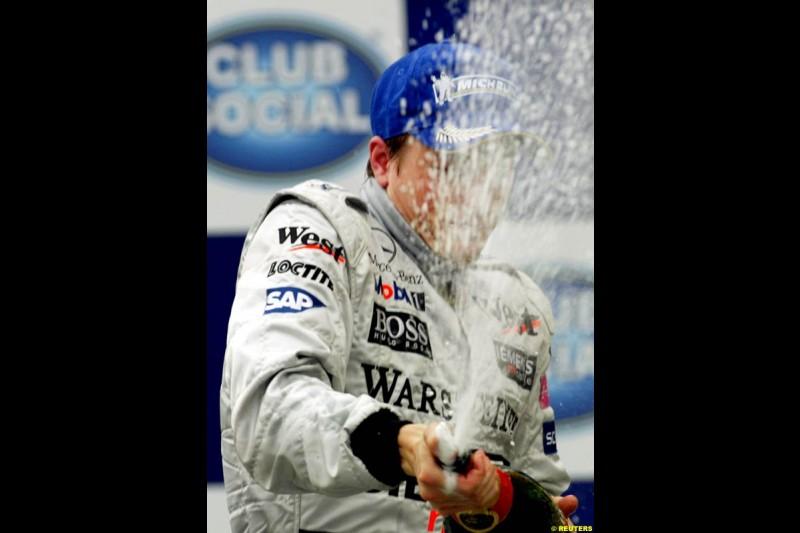 Kimi Raikkonen, McLaren, celebrates his second victory in a row. Brazilian Grand Prix. Interlagos, Sao Paulo, April 6th 2003.