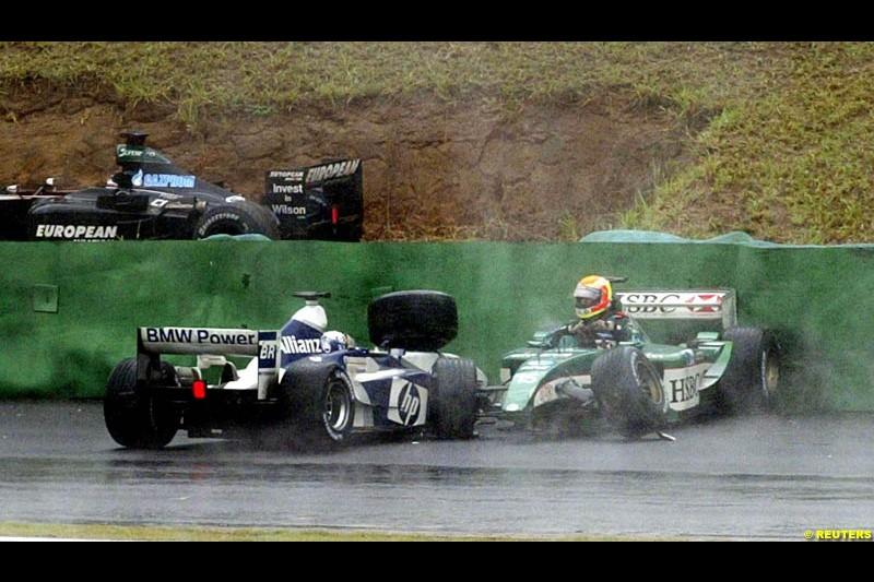 Antonio Pizzonia, Jaguar, comes to a halt next to Juan Pablo Montoya, Williams. Brazilian Grand Prix. Interlagos, Sao Paulo, April 6th 2003.
