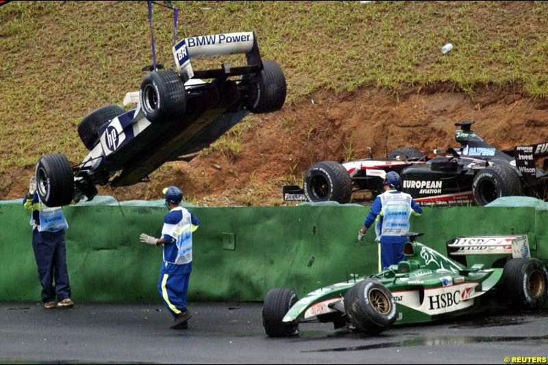A collection of cars after turn 3 caught many drivers out due to wet conditions. Brazilian Grand Prix. Interlagos, Sao Paulo, April 6th 2003.