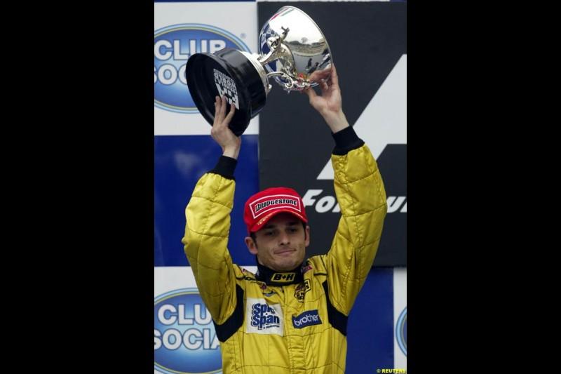 Giancarlo Fisichella . Jordan, celebrates 2nd place. Brazilian Grand Prix. Interlagos, Sao Paulo, April 6th 2003.