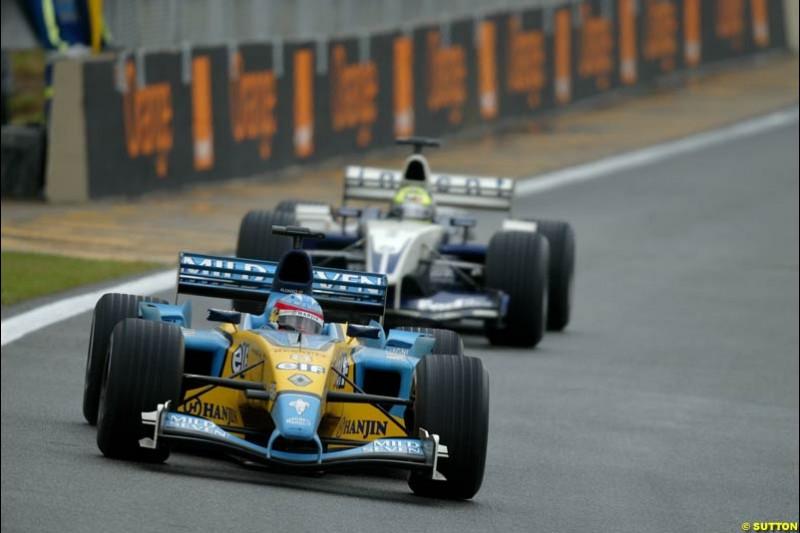 Fernando Alonso, Renault, leads Juan Pablo Montoya, Williams. Brazilian Grand Prix. Interlagos, Sao Paulo, April 6th 2003.