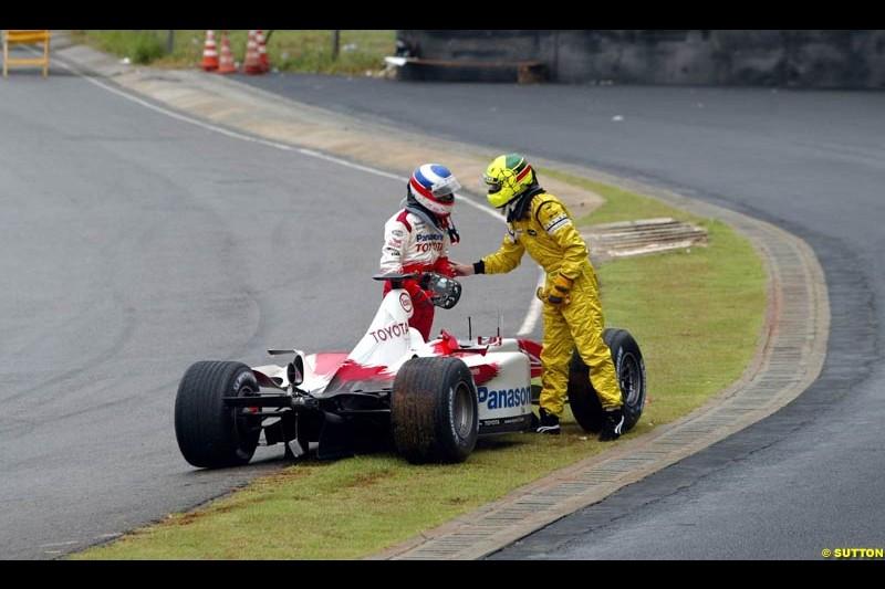 Olivier Panis, Toyota, and Ralph Firman, Jordan, discuss their accident. Brazilian Grand Prix. Interlagos, Sao Paulo, April 6th 2003.