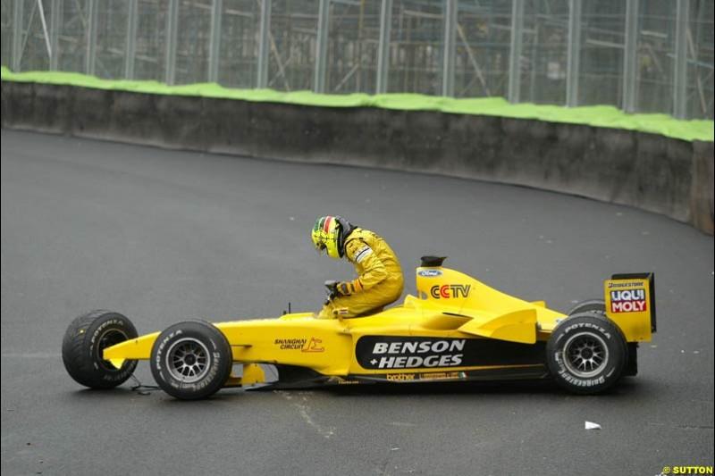 Ralph Firman steps out of his Jordan after crashing out. Brazilian Grand Prix. Interlagos, Sao Paulo, April 6th 2003.