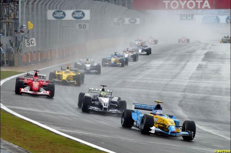 Jarno Trulli, Renault, leads the pack during a safety car period. Brazilian Grand Prix. Interlagos, Sao Paulo, April 6th 2003.