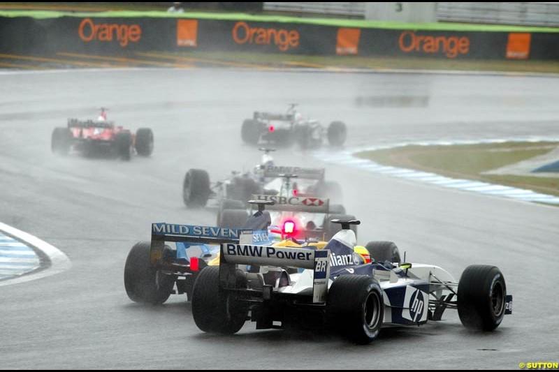 Jarno Trulli, Renault, passes Ralf Schumacher, Williams. Brazilian Grand Prix. Interlagos, Sao Paulo, April 6th 2003.