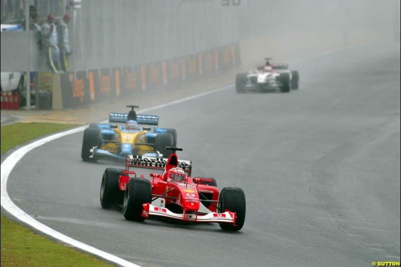 Rubens Barrichello, Ferrari, leads Jarno Trulli, Renault. Brazilian Grand Prix. Interlagos, Sao Paulo, April 6th 2003.