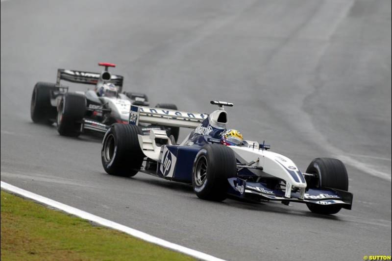 Juan Pablo Montoya, Williams, followed by David Coulthard, McLaren. Brazilian Grand Prix. Interlagos, Sao Paulo, April 6th 2003.