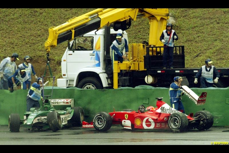 A collection of cars sits on the exit of turn 3 after wet conditions caught several drivers out. Brazilian Grand Prix. Interlagos, Sao Paulo, April 6th 2003.