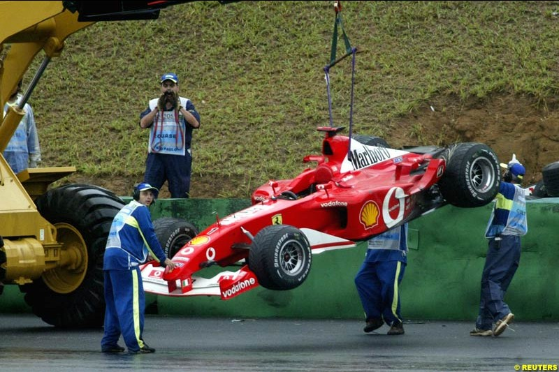 Michael Schumachers Ferrari is lifted from the circuit after the German crashed out of the Brazilian Grand Prix. Interlagos, Sao Paulo, April 6th 2003.