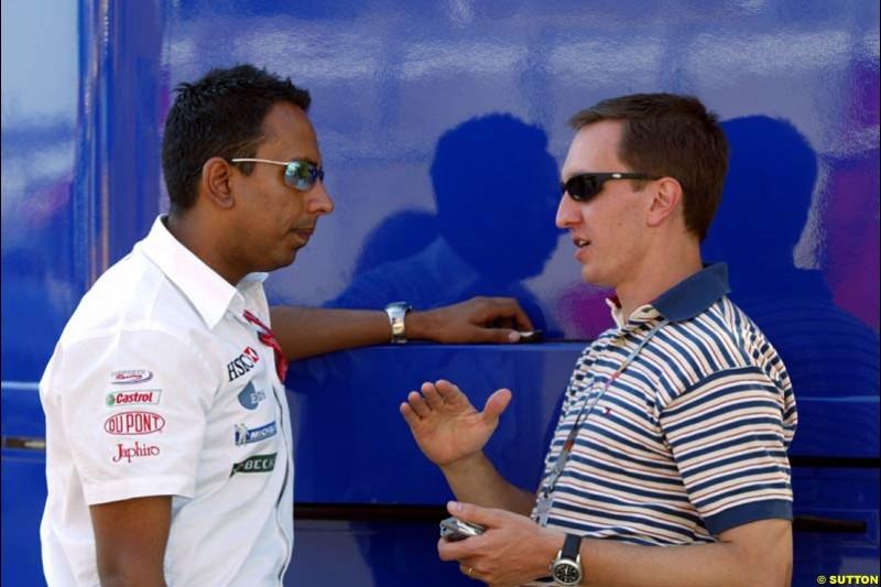 Jaguar's communications director Nav Sidhu with Luciano Burti. Friday at the Circuit de Catalunya, Barcelona, Spain. May 2nd 2003