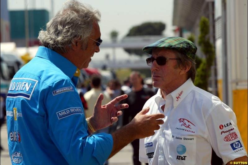 Flavio Briatore and Jackie Stewart. Friday, Spanish Grand Prix at the Circuit de Catalunya. Barcelona, Spain. May 2nd 2003.