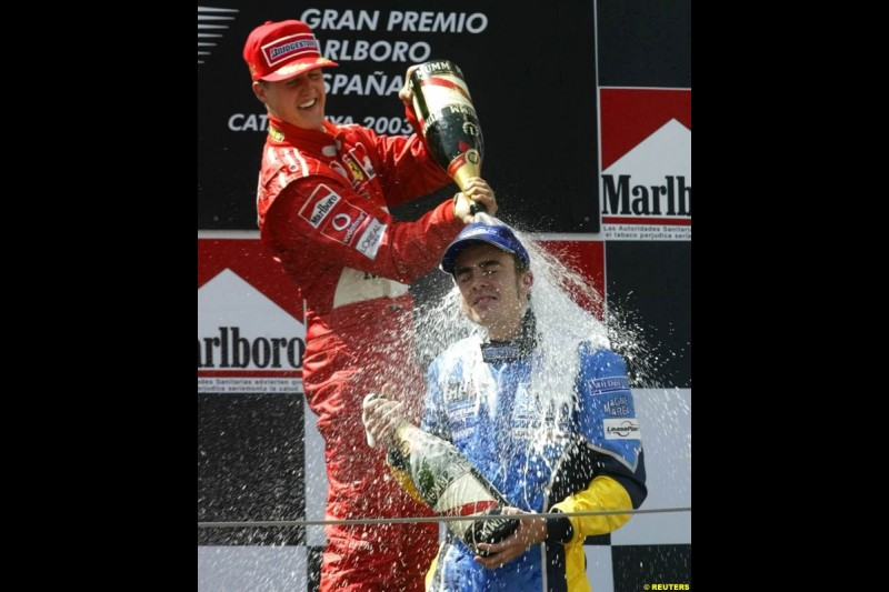 Michael Schumacher, Ferrari, celebrates victory with Fernando Alonso, Renault. Spanish Grand Prix. Circuit de Catalunya, Barcelona, Spain. May 4th 2003.