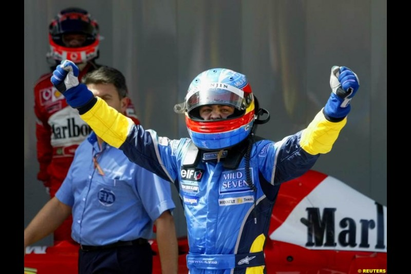 Fernando Alonso, Renault, celebrates second place. Spanish Grand Prix. Circuit de Catalunya, Barcelona, Spain. May 4th 2003.