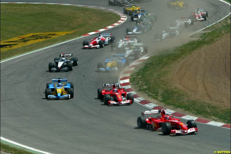 The first lap. Spanish Grand Prix. Circuit de Catalunya, Barcelona, Spain. May 4th 2003.
