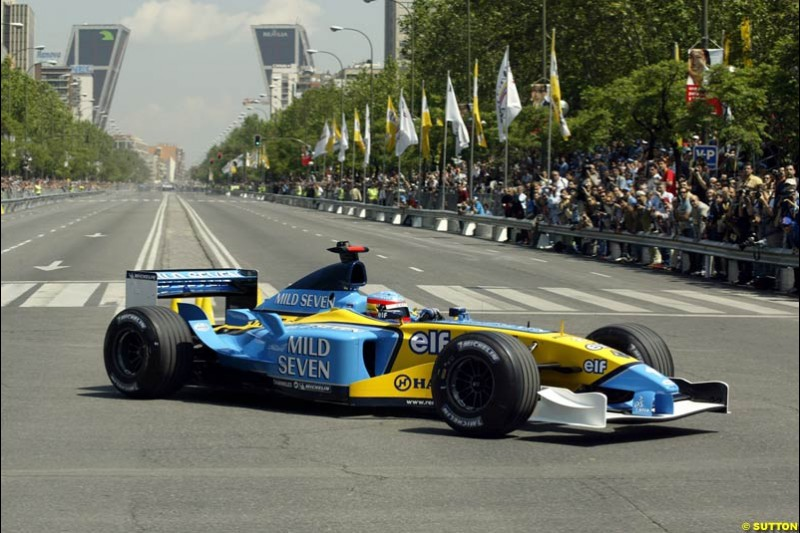 Renault's Fernando Alonso speeds down Madrid's central Paseo de la Castellana during an exhibition celebrating his success so far this season. May 11th 2003.