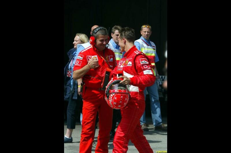Michael Schumacher, Ferrari, celebrates pole position. Austrian Grand Prix. A1-Ring, Spielberg, Austria. May 17th 2003.