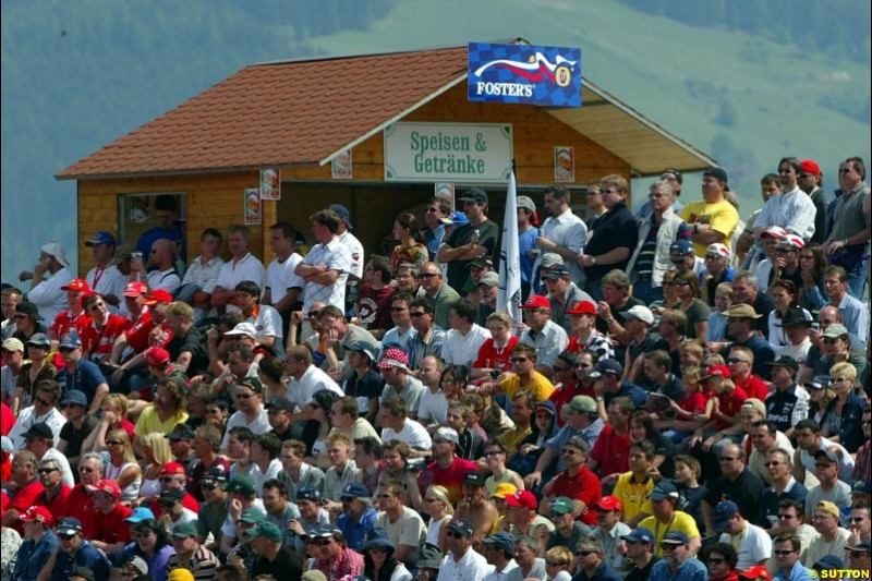 The fans during qualifying for the Austrian Grand Prix. A1-Ring, Spielberg, Austria. May 17th 2003.