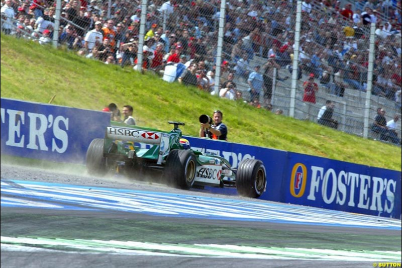 Mark Webber, Jaguar, takes to the dirt during qualifying for the Austrian Grand Prix. A1-Ring, Spielberg, Austria. May 17th 2003.