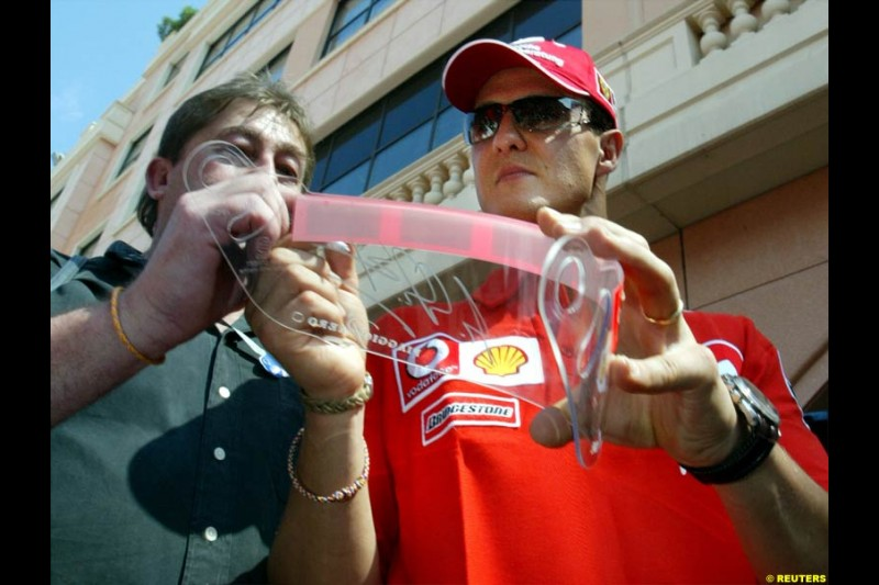 Michael Schumacher, Ferrari, signs autographs. Wednesday, Monaco Grand Prix, Monte Carlo. May 28th 2003.