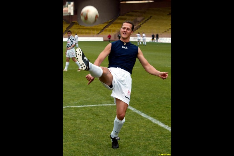 Michael Schumacher warms up prior to a soccer match between the Star team for children and Formula One drivers in Monaco May 27, 2003. The event was set up for the benefit of A.M.A.D.E, a Monegasque association which helps children all around the world