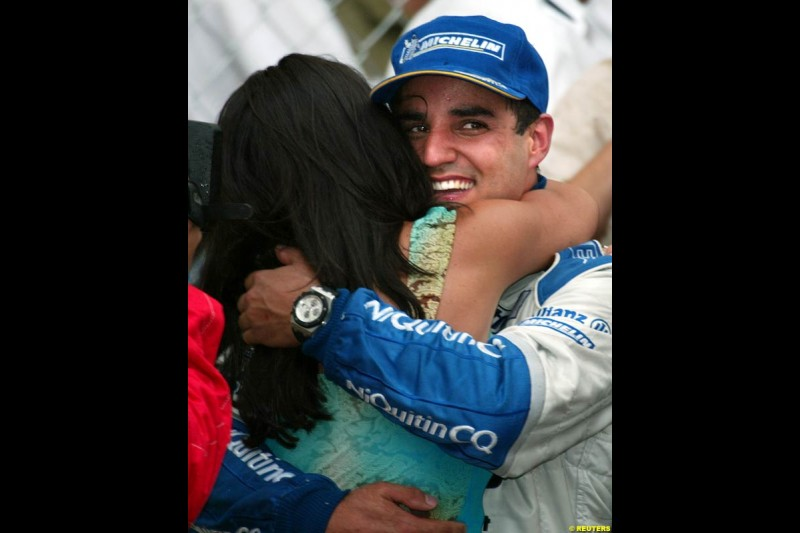 Juan Pablo Montoya, Williams, hugs wife Connie after securing his second Formula One victory. Monaco Grand Prix, Sunday, June 1st 2003.