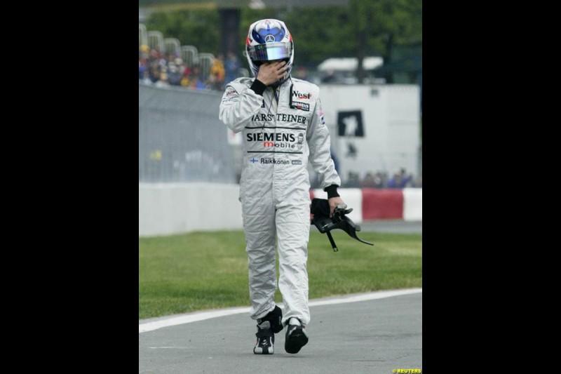 Kimi Raikkonen, McLaren, walks back to the pits. Canadian Grand Prix, Montreal, Saturday, June 14th 2003.