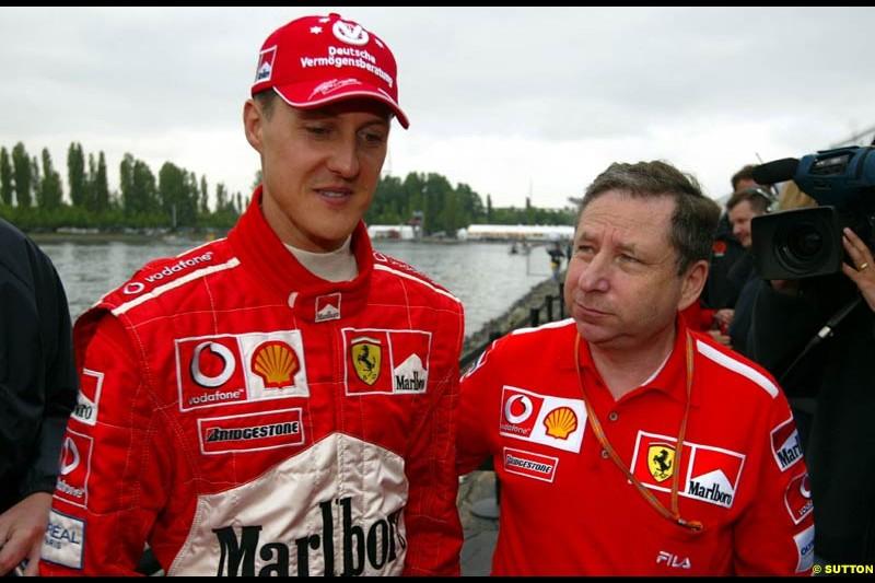 Jean Todt, Ferrari General Manager, chats to Michael Schumacher, Ferrari. Canadian Grand Prix, Montreal, Saturday, June 14th 2003.