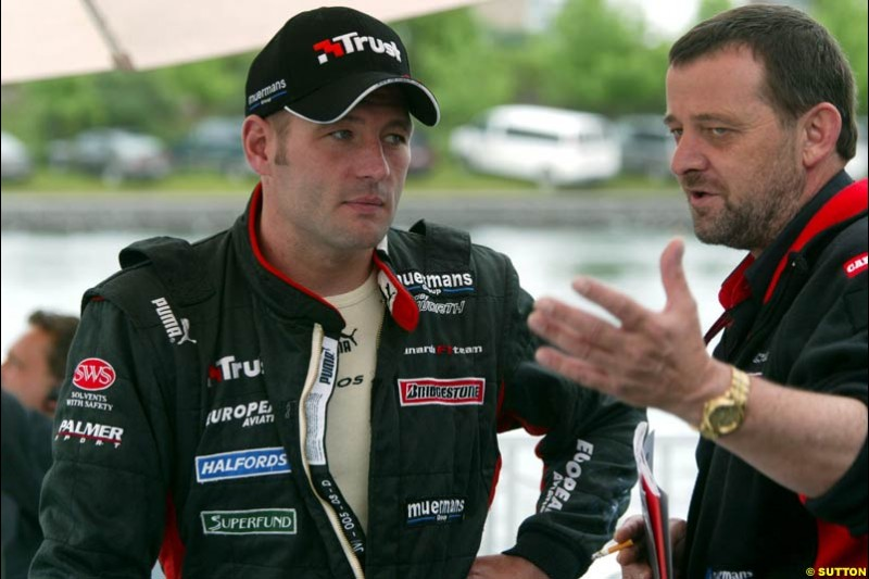 Paul Stoddart, Minardi Team Principal, chats to Jos Verstappen, Minardi. Canadian Grand Prix, Montreal, Saturday, June 14th 2003.