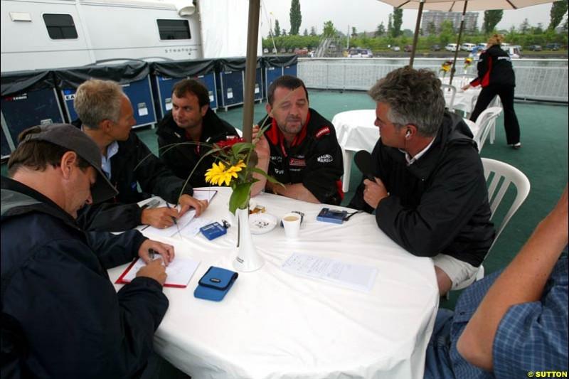 Paul Stoddard, Minardi Team Principal, chats to the press. Canadian Grand Prix, Montreal, Saturday, June 14th 2003.